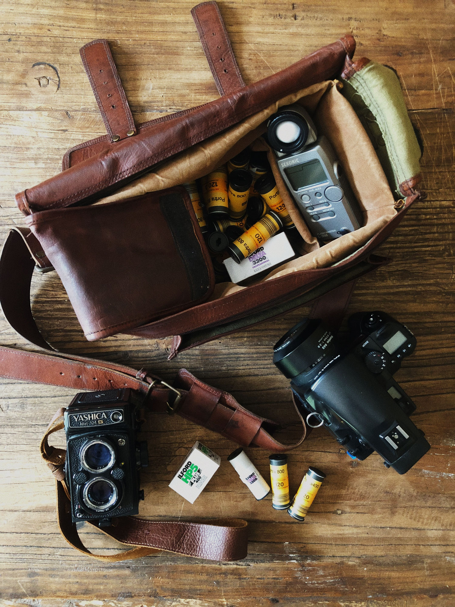 Open Camera Bag, Cameras, and Rolls of Film